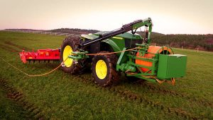 Renewable energy for farms with the John-Deere-GridCON-tractor